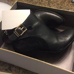 Sleek heeled black boots